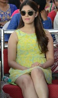 Surabhi Looks So cute and beautiful in Short Lemon Sleeveless Kurti and black Shades