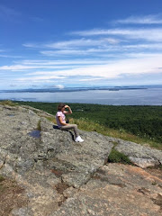 Sitting on the rocks in Maine