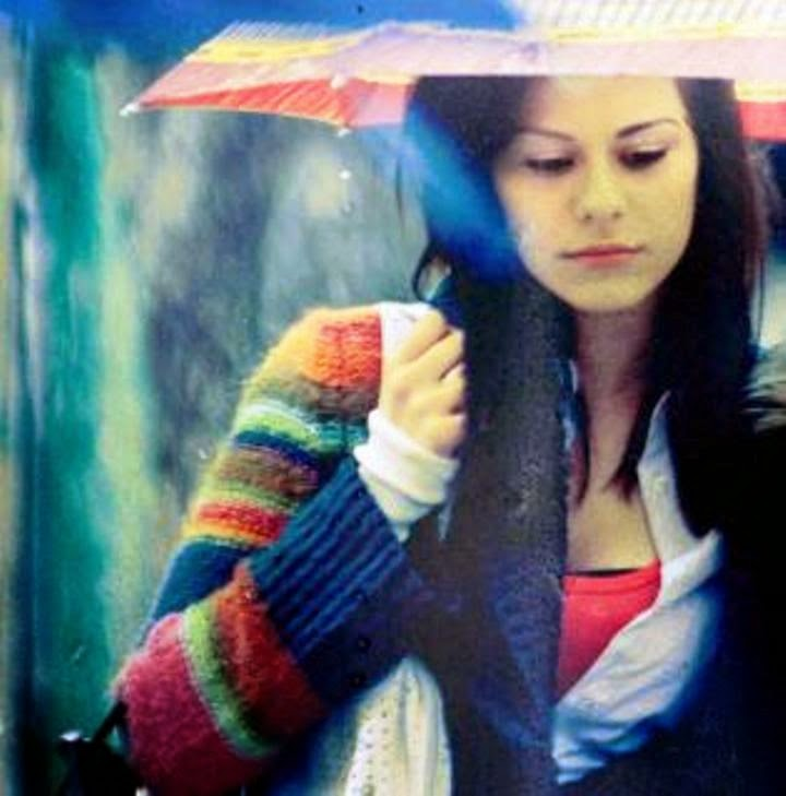 Sweet cute girl in rain with umbrella.jpg