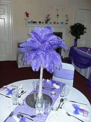 centros de mesa con plumas decoracin de bodas