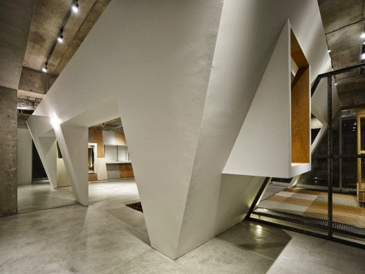 bird house shaped loft shows a unique home design with its tilting and wide block entrances