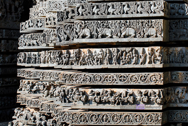 The view of the friezes at the zig-zag structure of the temple walls, here you can see the row above the horses consists of tales and scenes from Indian epics