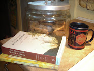 Some of my favourite things.  Tea, Arsenal (mug), ginger cookies in the jar, and books.