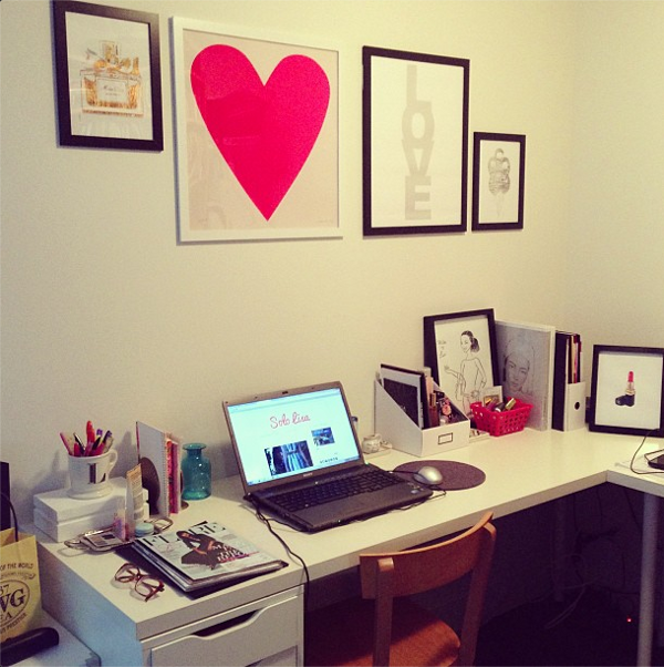 Vancouver-based beauty and style blogger Solo Lisa's home office space, featuring white furniture and framed prints.