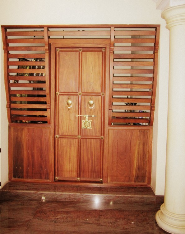 Kerala style carpenter works and designs decorating pooja - Pooja room door designs in kerala ...