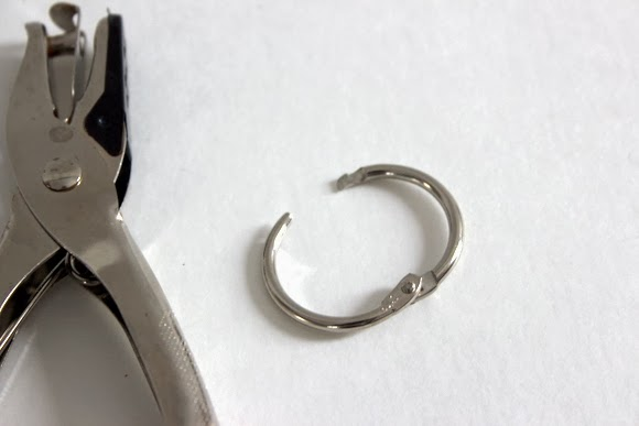 All you need for a Christmas Card Book is a hole punch a ring to keep the cards together!