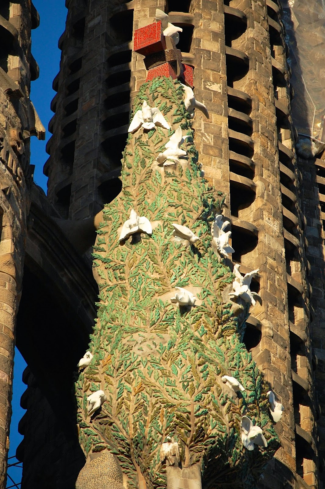 Holy Spirit doves circle the cypress tree on the Nativity Facade, Sagrada Familia