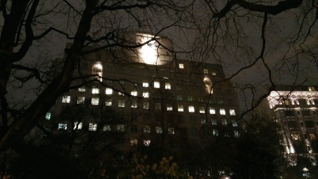 Image of an eerie building and tree's on the banks of the thames in london