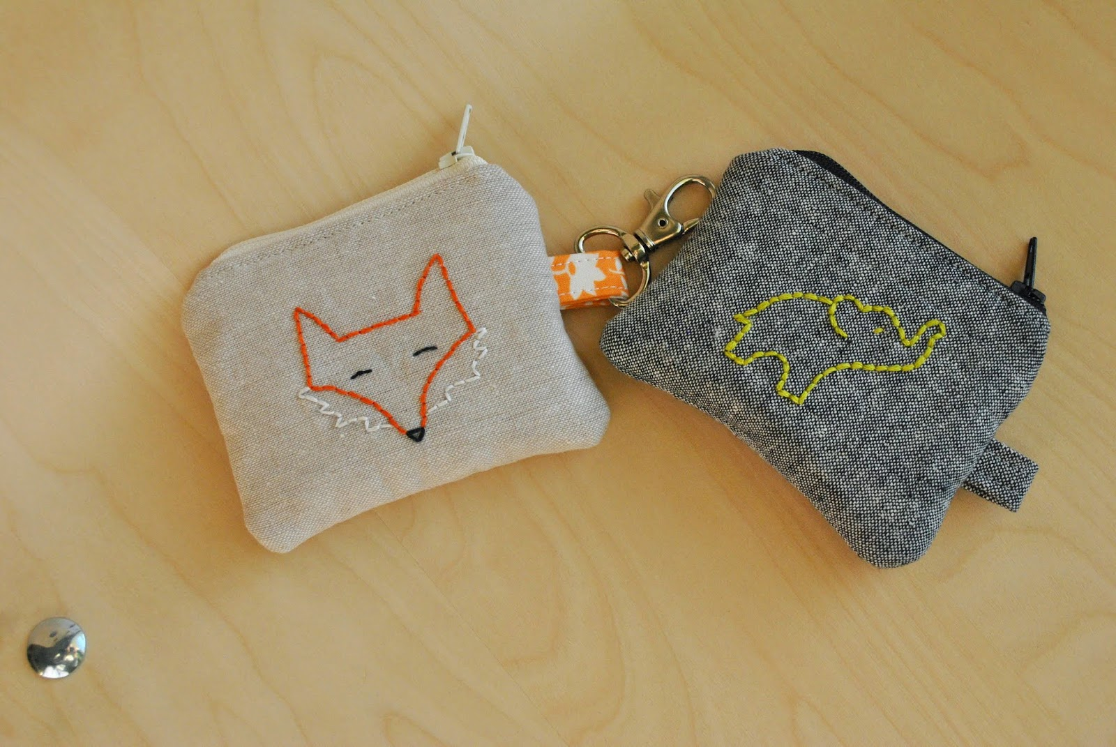 embroidered elephant and fox coin purses