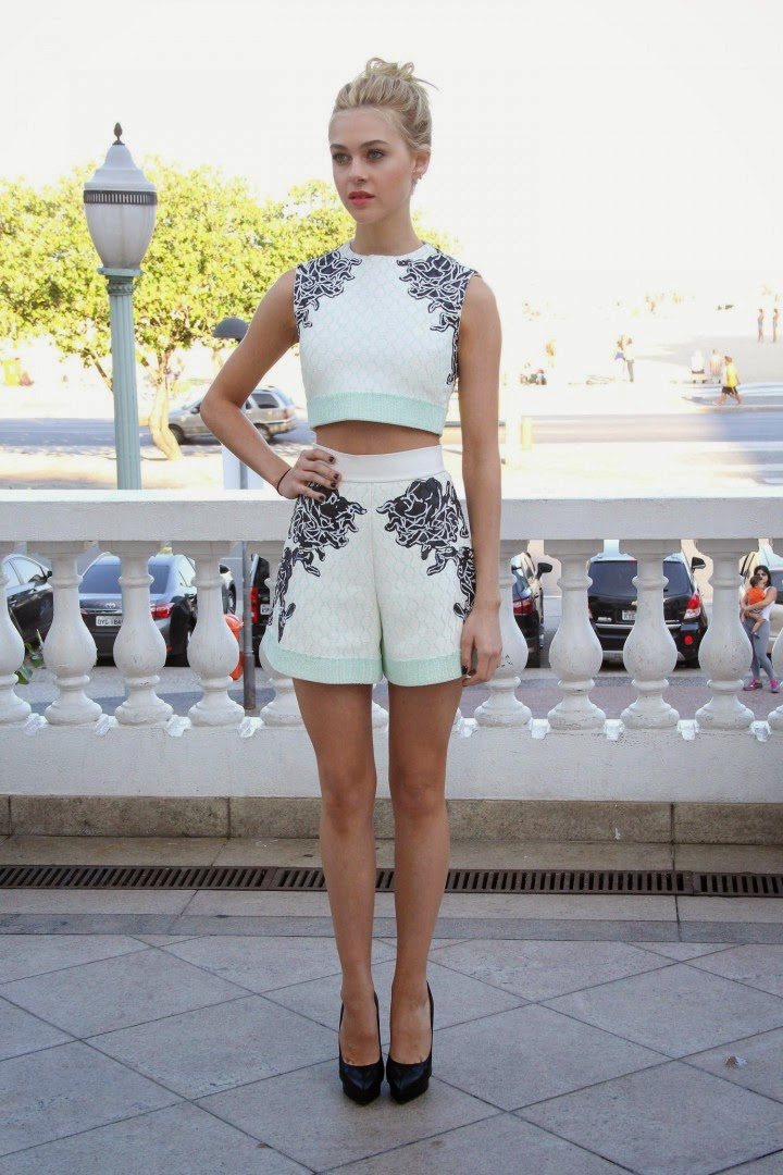 Nicola Peltz in a cropped top and flared shorts at the 'Transformers: Age of Extinction' Rio de Janeiro photocall
