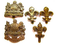 Badges of the Manchester Regiment. In 1923, the badges changed to the fleur-de-lis.