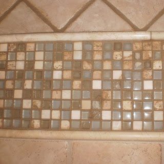 Mosaic natural stone design with marble trim diagonal 6x6 tile-shower