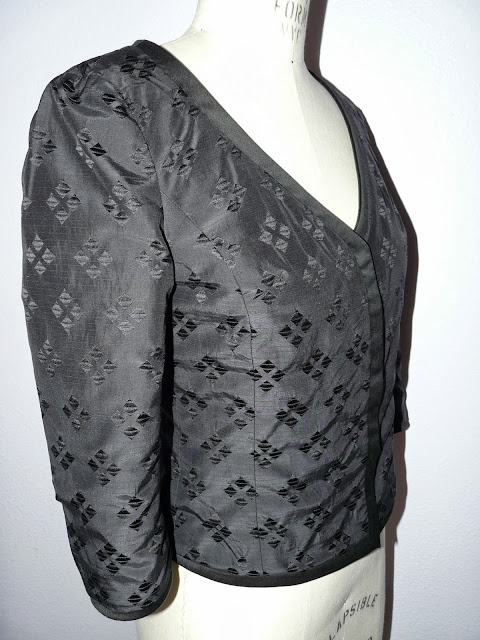 Fitted jacket made from Oscar de la Renta bouclé from Mood Fabrics and a BurdaStyle pattern. Lining side shown here.