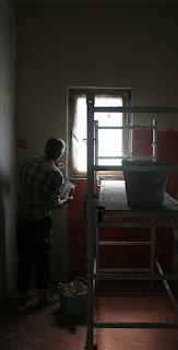Sally plastering the bathroom