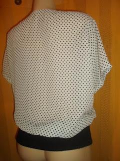 blusa de  bolinhas  com barra em lã  em poliéster
