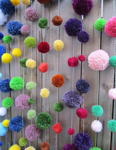Pom+pom+garlands+on+the+fence edited 1