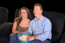 Couple relaxing on Home theater Seats with Popcorn