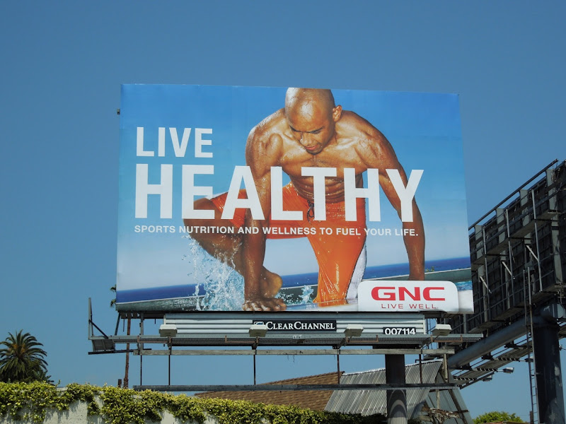 GNC Live Healthy swimmer billboard