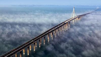 Aerial view of Jiaozhou Bay Bridge in Qingdao, east China's Shandong Province (© Yan Runbo/Corbis) 438