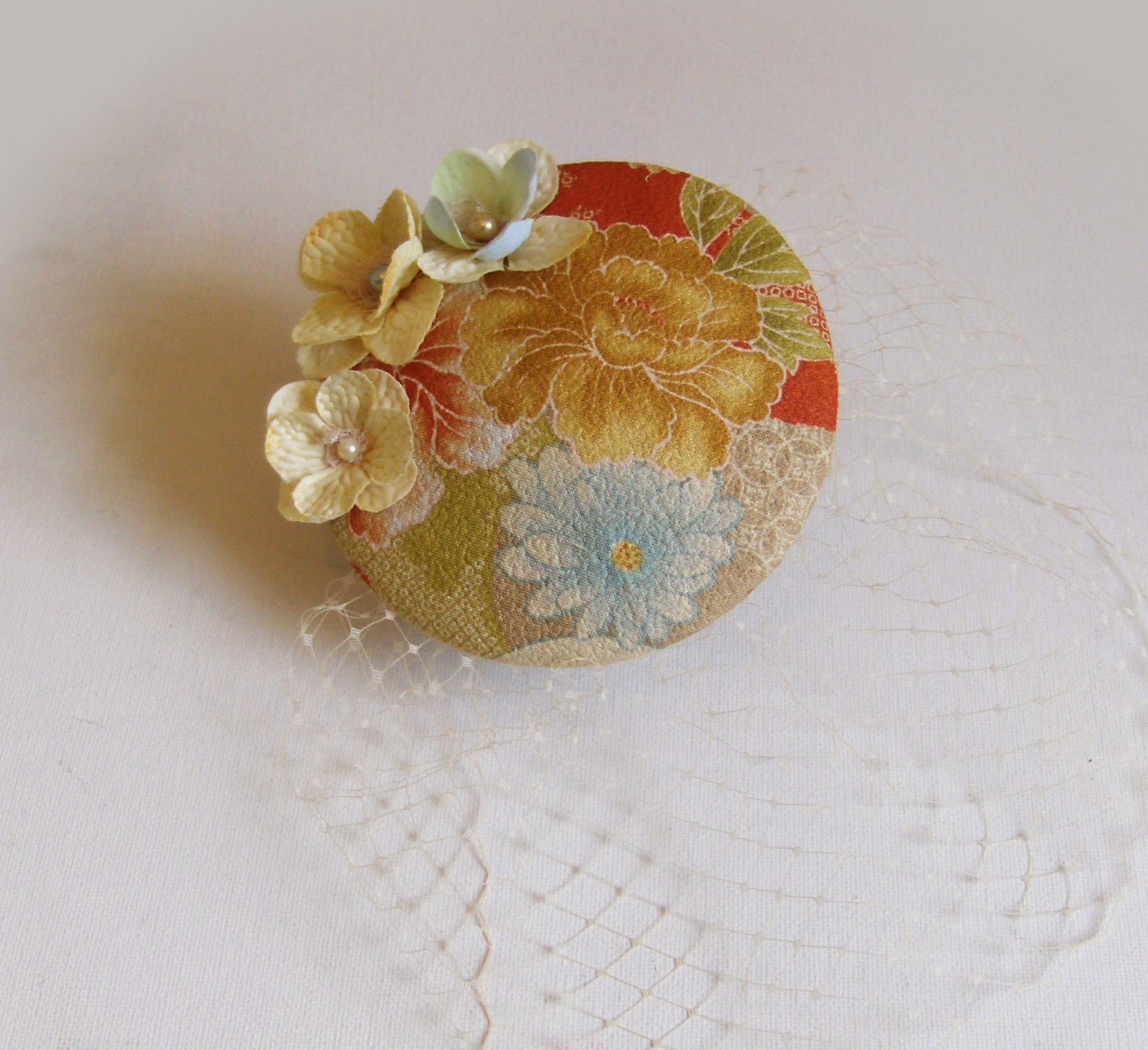 http://folksy.com/items/4415962-Cocktail-hat-gold-sakura-blossoms-