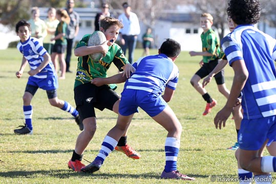 With ball: Gus Andrews, Havelock North Intermediate - annual Cunningham Cup rugby match between Havelock North Intermediate, Havelock North (green), and Heretaunga Intermediate, Hastings (blue). HNI won 45-25. photograph
