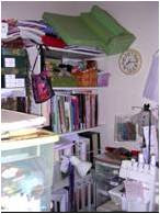 cluttered shelves in sewing room