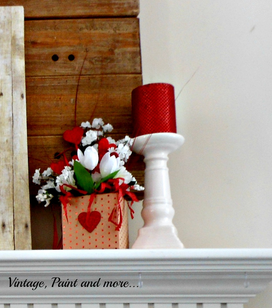 A Valentine  flower arrangement made with faux flowers and paper covered box