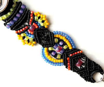 Close up of macrame knotting with colorful seed beads.