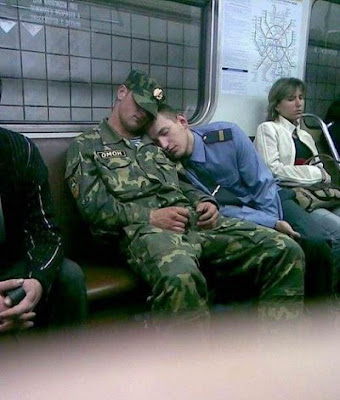 funny picture of policeman and a soldier sleeping side by side