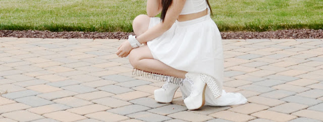 More photos of the lovely all-white summer OOTD, with the WalkTrendy asymmetric-hem cutout dress, a white Chicnova leather bracelet, and white spiked Jeffrey Campbell Lita platform heels dupes.