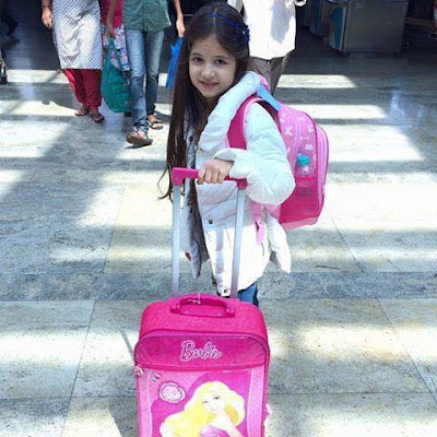 Munni aka harshaali photo with travel bag