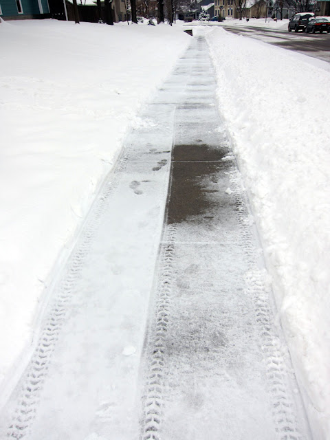 sidewalk with snow plowed