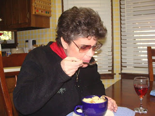Laurel tasting matzo ball soup