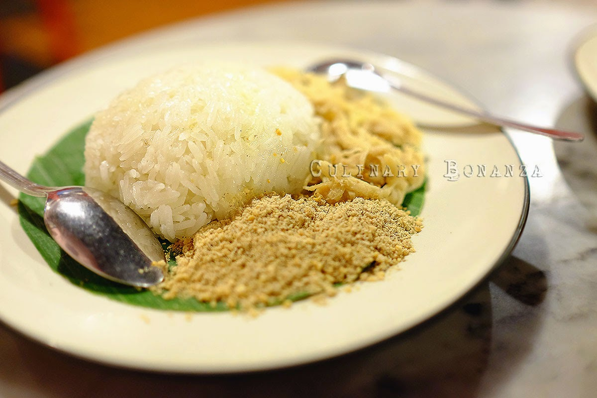 Ketan Bumbu (glutinous rice served with shredded coconut and chicken)