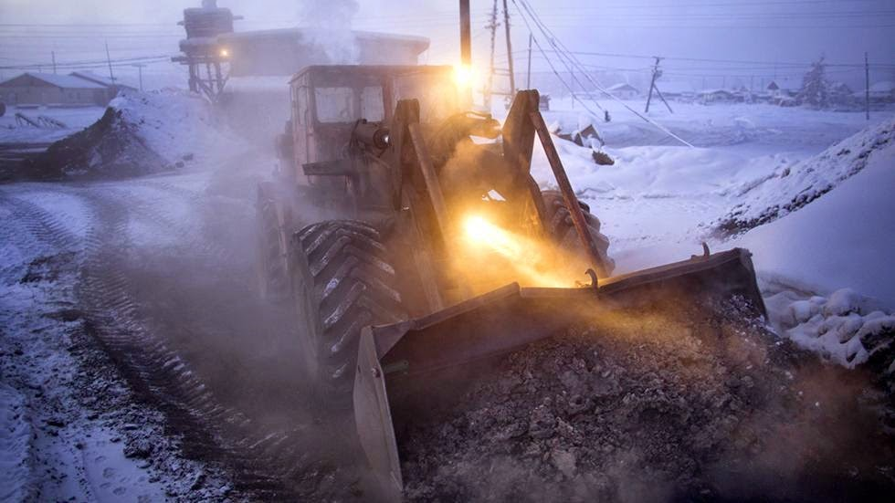 Heating for Oymyakon is provided by a coal-fired water heating plant. Every morning this digger delivers fresh coal to the plant and carries away the burnt cinder. - Welcome to The Coldest Place Inhabited By Humans on Earth