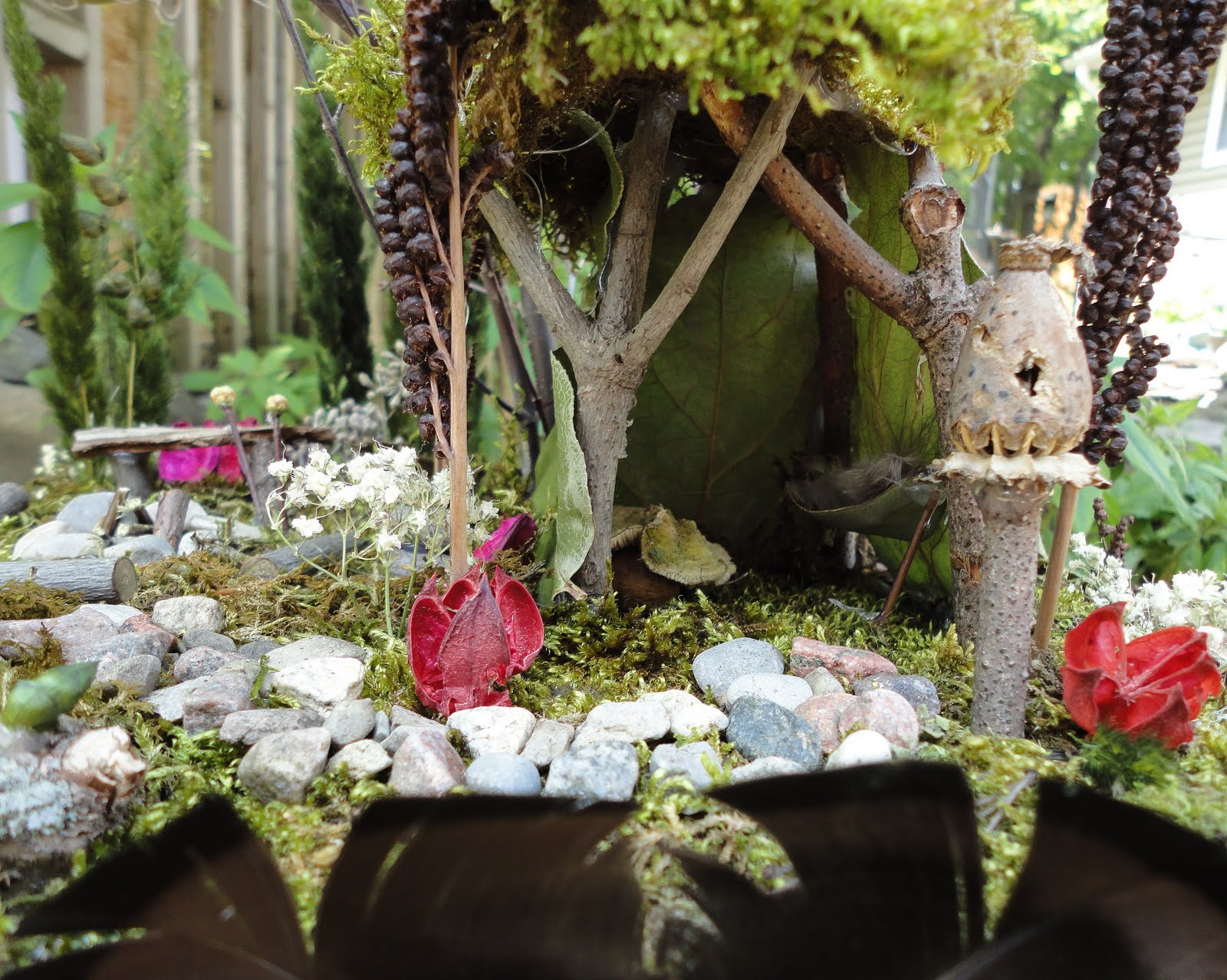 On The Forest Floor Sits A Tiny House Made Of Sticks Leaves And Moss