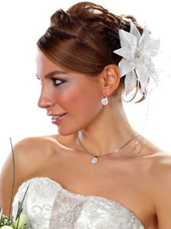 wedding updos with flower hair accessories