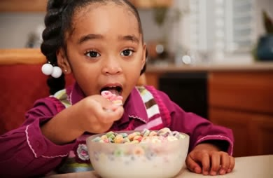 Black girl eating breakfast