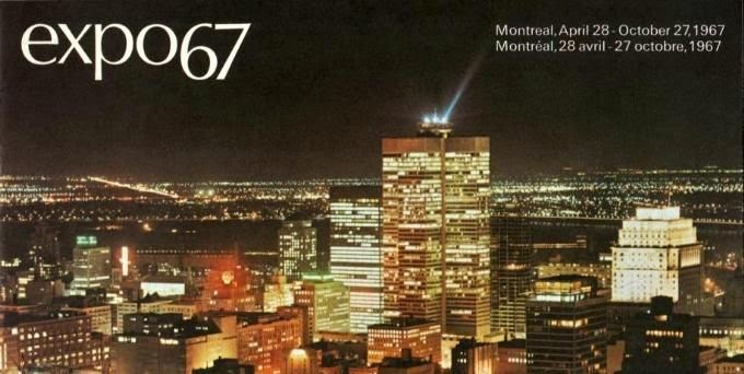 Postcard of Expo' 67. Colour city scape of Montreal at night, bright lights on city buildings.