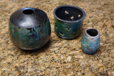 Glazed raku pottery pots / vessels / vases, including a candleholder.