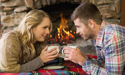6 Romantic Ideas To Celebrate Her Birthday, man woman drink in mugs cups fireplace winter