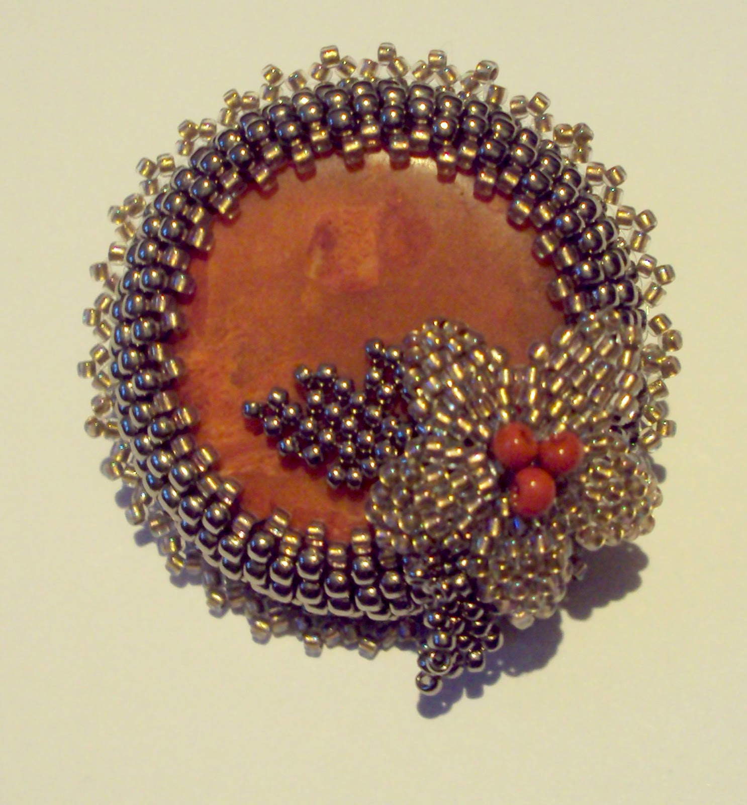 curious case of coral brooch
