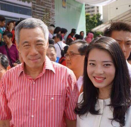 She managed to have her picture taken with none other than Prime Minister Lee Hsien Loong himself two years ago
