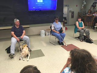 Audrey, Laurel and Kimberly presenting for day campers at BARK Camp