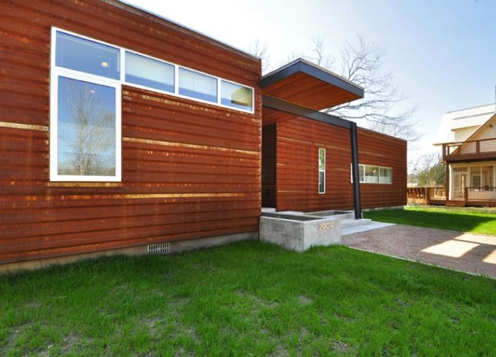 Custom prefab modular house with patinated metal facade for Prefab homes austin