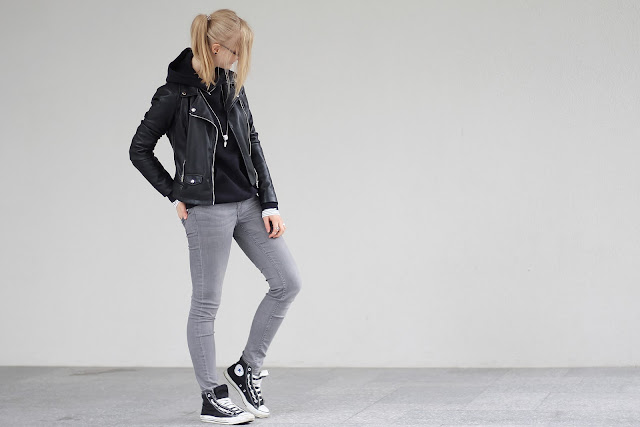 black leather jacket and grey denim