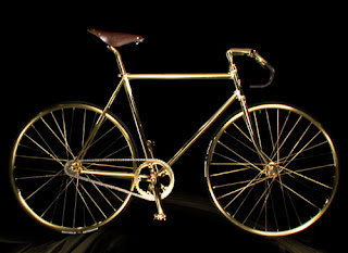 A gold fixed gear bike