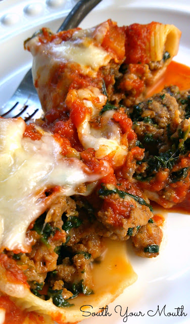 Classic Stuffed Shells with Italian sausage, ground beef, spinach, garlic and herbs stuffed in jumbo shells then topped with sauce and cheese!