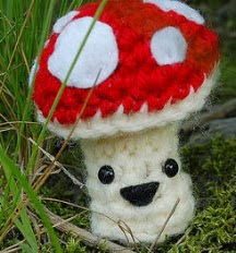 http://www.innerchildcrochet.com/patterns/files/happy_little_mushroom.pdf