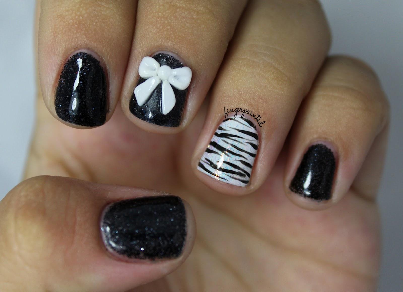 http://1.bp.blogspot.com/-4pSwelxbK_g/UBoUEfZp_JI/AAAAAAAACH4/hObuNgbq57M/s1600/black-bow-nails.jpg